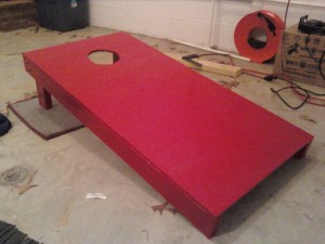 cornhole board painted red