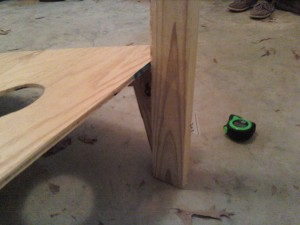 cornhole board and tape measure